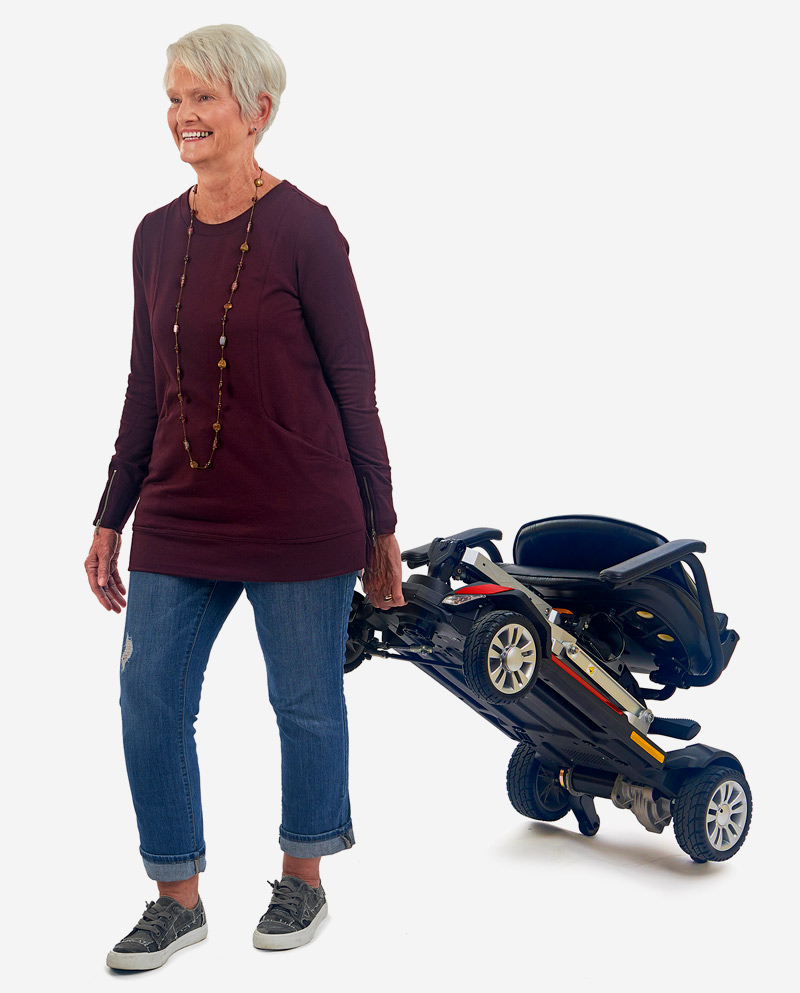 Woman pulling folded scooter