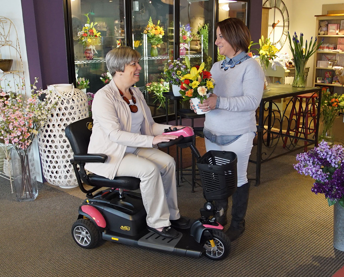 Mothers Day at the Flower Shop in a Pink Buzzaround scooter