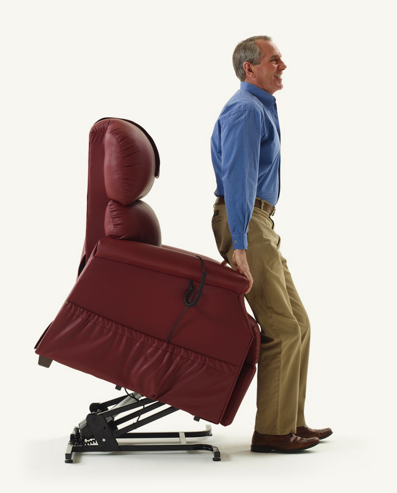 Man using lift chair to stand up