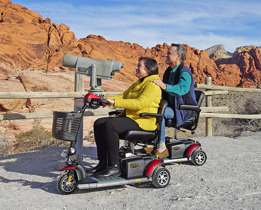 Couple on scooters sightseeing in the desert