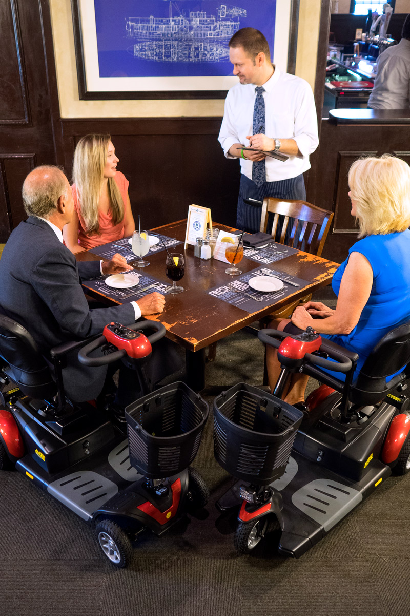 family with wheelchairs at restaurant